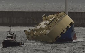Stricken vessel Modern Express is towed by another ship entering at the port of the northern Spanish city of Bilbao, Wednesday, Feb. 3, 2016. A large cargo ship that went adrift last week in the Bay of Biscay is poised to arrive in the northern Spanish port of Bilbao following a towing operation that has lasted days. (AP Photo/Alvaro Barrientos) ORG XMIT: EM113